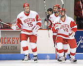Colby Cohen (BU - 25), Kevin Shattenkirk (BU - 3), Corey Trivino (BU - 10) - The Boston University Terriers defeated the Merrimack College Warriors 6-4 on Saturday, November 14, 2009, at Agganis Arena in Boston, Massachusetts.