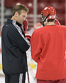 Assistant Coach Mark Osiecki chats with Aaron Bendickson 19 of the University of Wisconsin.  The University of Wisconsin Badgers participate in a morning skate on Saturday, October 28, 2006 at the Kohl Center in Madison, Wisconsin.  The Badgers played host to the Boston College Eagles for a weekend series, the first meetings between the teams since Wisconsin defeated Boston College for the national championship in April 2006.<br />