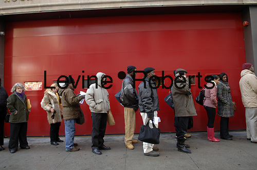 Hundreds of people line up in New York on Tuesday, March 3, 2009 for a job fair sponsored by Diversity Job Fairs. The Federal Government will release the unemployment figures for February 2009 on Friday. (© Frances M. Roberts)