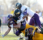 MANKATO, MN - NOVEMBER 1:  Connor Thomas #5 from Minnesota State Mankato is brought down by Broughan Jantz #47 and John Tidwell #26 for the University of Sioux Falls in the second quarter Saturday afternoon at Blakeslee Stadium in Mankato. (Photo by Dave Eggen/Inertia)