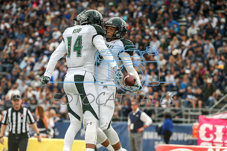 Hawaii wide receiver Devan Stubblefield (9) celebrates with teammate Marcus Kemp (14) after scoring against Nevada during the first half of an NCAA college football game in Reno, Nev., on Saturday, Oct. 24, 2015. (AP Photo/Cathleen Allison)