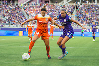 Orlando, Florida - Saturday, April 23, 2016: Houston Dash midfielder Amber Brooks (12) is pressured by Orlando Pride defender Stephanie Catley (7) during an NWSL match between Orlando Pride and Houston Dash at the Orlando Citrus Bowl.