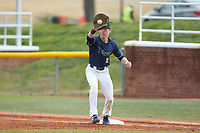 Wingate Bulldogs first baseman Mitch Farris (15) fields a throw during the game against the Concord Mountain Lions at Ron Christopher Stadium on February 1, 2020 in Wingate, North Carolina. The Bulldogs defeated the Mountain Lions 8-0 in game one of a doubleheader. (Brian Westerholt/Four Seam Images)