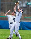 WASHINGTON,  CT-041819JS15- Shepaug's Jack Pesce  (28) left, backs off as teammate (13) calls for a the pop-up during their game against Northwestern Thursday at Tex Alex Field in Washington.  <br /> Jim Shannon Republican American