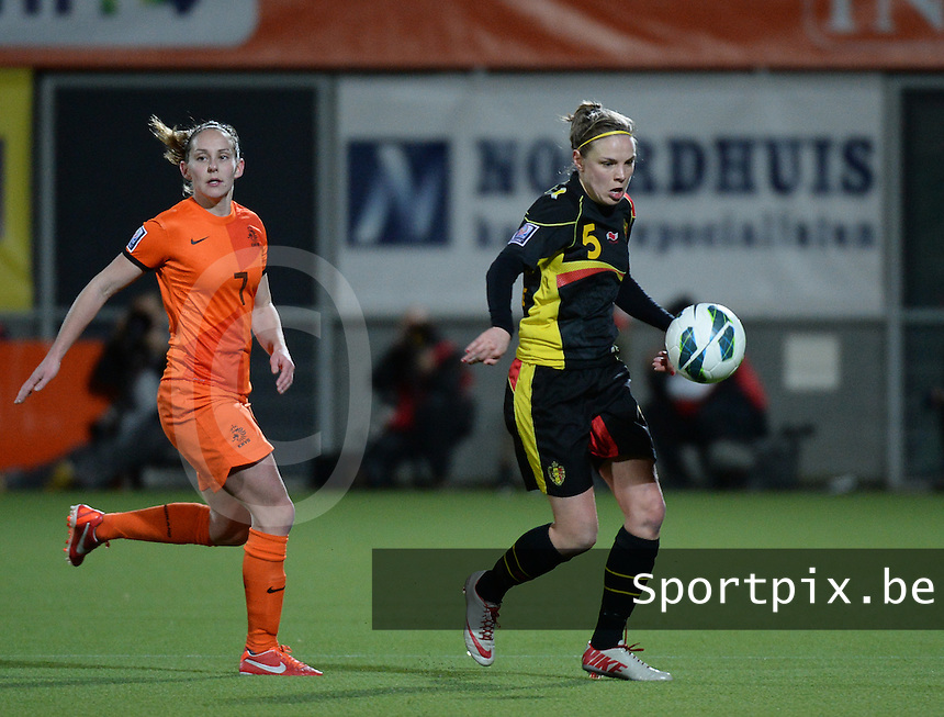 20140212 - ZWOLLE , THE NETHERLANDS : Belgian Lorca Van De Putte (5) pictured with Dutch Manon Melis (7) during the female soccer match between The Netherlands and Belgium , on the fifth matchday in group 5 of the UEFA qualifying round to the FIFA Women World Cup in Canada 2015 at Het Ijseldelta Stadion , Zwolle . Wednesday 12th February 2014 . PHOTO DAVID CATRY