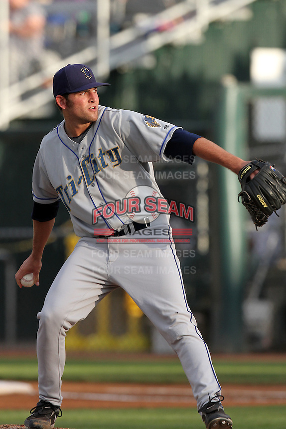 Tri-City Dust Devils pitcher Chris Jensen #18 pitches against the Everett Aquasox at Everett Memorial Stadium on August 13, 2011 in Everett,Washington. Everett defeated Tri-City 6-4.(Larry Goren/Four Seam Images)