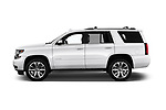 Car driver side profile view of a 2018 Chevrolet Tahoe Premier 2WD 5 Door SUV
