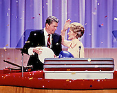 United States President Ronald Reagan and first lady Nancy Reagan on the podium of the 1988 Republican Convention at the Super Dome in New Orleans, Louisiana on August 15, 1988.<br /> Credit: Arnie Sachs / CNP