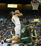 Nevada's Cody Martin shoots over Colorado State's Che Bob in the first half of an NCAA college basketball game in Reno, Nev., Sunday, Feb. 25, 2018. (AP Photo/Tom R. Smedes)