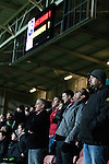 Wrexham 1 Brighton & Hove Albion 1, 18/01/2012. Racecourse Ground, FA Cup 3rd Round Replay. Wrexham fans in the Eric Roberts Building Services Stand reacting with disbelief at a missed chance during extra time against Brighton and Hove Albion in an FA Cup third round replay, at the Racecourse Ground played following the teams one-all draw in the first match. The replay was won by Brighton, 5-4 on penalty kicks after the match had ended in a one-all draw after extra time, watch by a crowd of 8316. The visitors played in the Championship, three leagues above their rivals from Wales, who were top of the Conference at the time of the match. Photo by Colin McPherson.