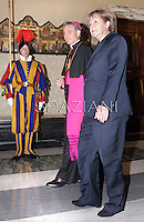 Monsignor Georg Gaenswein.Pope Francis receives German Chancellor Angela Merkel during a private audience at the Vatican on May 18, 2013.