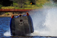 Frame  8: #42 rides up and over the roostertail of leader R.J. West, (#93) during the final heat.   (SST-45 class)