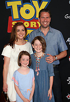 "HOLLYWOOD, CA - JUNE 11: Alyson Hannigan, Alexis Denisof, Satyana Marie Denisof, Keeva Jane Denisof, at The Premiere Of Disney And Pixar's ""Toy Story 4"" at El Capitan theatre in Hollywood, California on June 11, 2019. <br /> CAP/MPIFS<br /> ©MPIFS/Capital Pictures"