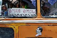Gori/Georgia  9-2008.<br /> Profughi fuggiti dall'Ossezia del sud a bordo di un autobus diretto a Tbilisi. Sul vecchio autobus appare l'immagine di Stalin. Refugees fled from South Ossetia on board a bus to Tbilisi. On the old bus appears the image of Stalin.<br /> Photo Livio Senigalliesi