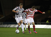 Marc McAusland under pressure from Andrew Ryan in the St Mirren v Hamilton Academical Scottish Communities League Cup match played at St Mirren Park, Paisley on 25.9.12.