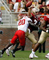 TALLAHASSEE, FL 10/31/09-FSU-NCST FB09 CH43-Florida State's Christian Ponder is taken to the ground by C.J. Wilson N.C. State's during second half action Saturday at Doak Campbell Stadium in Tallahassee. The Seminoles beat the Wolf Pack 45-42..COLIN HACKLEY PHOTO