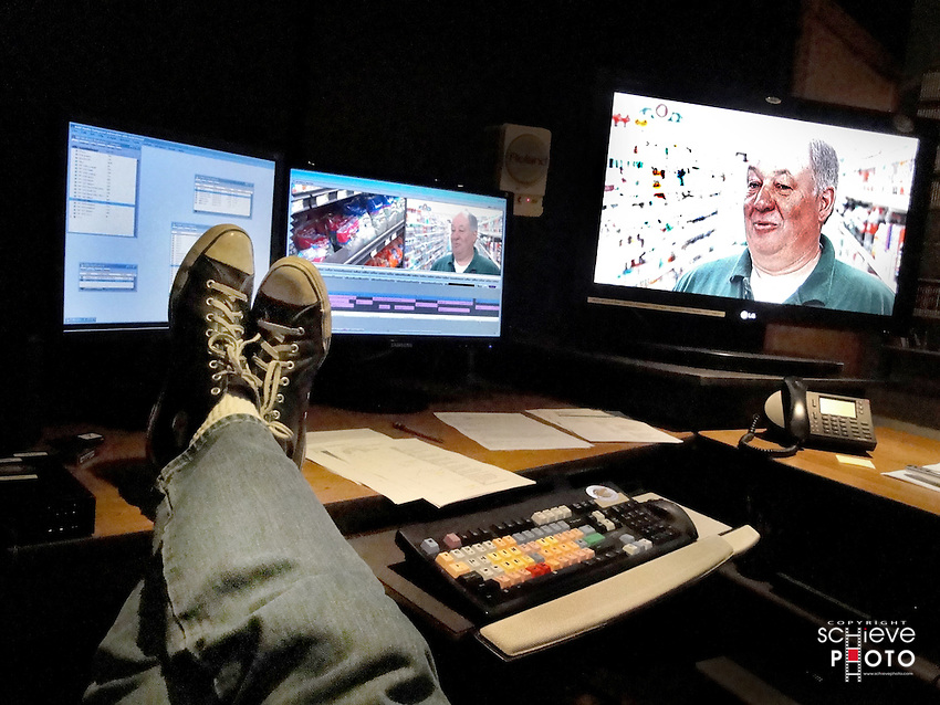 I take a break while editing some video on an Avid Adrenaline non-linear editing system at Tweedee Productions in Madison, Wisconsin.