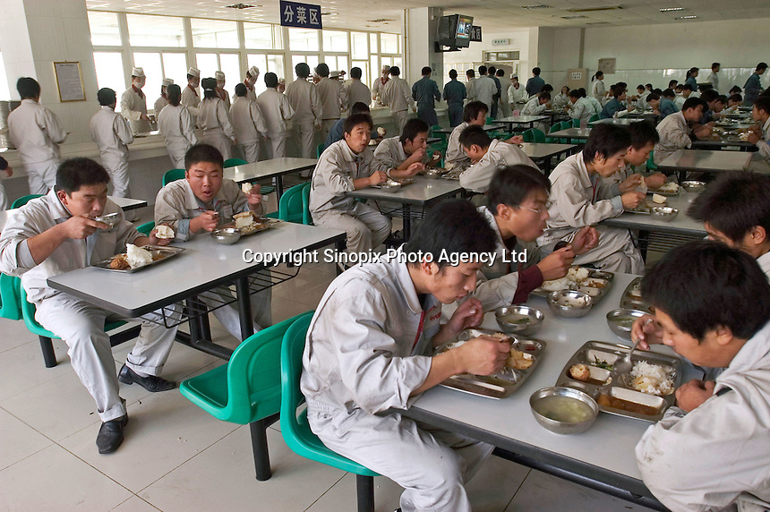 Workers of Baoding Great Wall (Changcheng) Automobile have lunch. Changcheng is one of China's largest producers of pickup trucks and SUVs. Changcheng exported 10,162 units vehicles in the first 9 months of 2005. The company is listed on the Hong Kong Stock Exchange. .