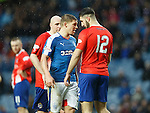 Aldin Zubaidi puts the head on Martyn Waghorn