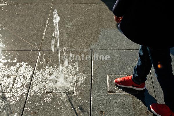 child playing with a water fountain Yokohama Japan