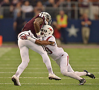 STAFF PHOTO BEN GOFF  @NWABenGoff -- 09/27/14 Arkansas cornerback Jared Collins, right, tacklesTexas A&M wide receiver Ricky Seals-Jones during the first quarter of the Southwest Classic in AT&T Stadium in Arlington, Texas on Saturday September 27, 2014.