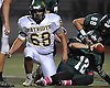 Stephen Torrico #68 of Ward Melville, left, gets to his feet after sacking Lindenhurst quarterback Austin Perri #12 in the second quarter of a Suffolk County Division I varsity football game at Lindenhurst Middle School on Friday, Oct. 7, 2016. Lindenhurst went to halftime leading 16-7.