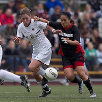 NC State forward Tanya Cain (25) on the attack as Boston College defender Alyssa Pember (6) defends. Boston College defeated North Carolina State,1-0, on Newton Campus Field, on October 23, 2011.