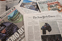 Copies of The New York Post, the NY Daily News and the New York Times over several days report on the February 8-9, 2013 blizzard that covered the Northeastern United States.  (© Richard B. Levine)