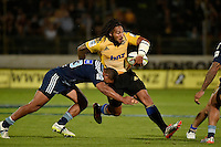 Ma'a Nonu ( Hurricanes ) and Charles Piutau ( Blues ) in action during the Super Rugby - Hurricanes v Blues at FMG Stadium, Palmerston North, New Zealand on Friday 13 March 2015. <br /> Photo by Masanori Udagawa. <br /> www.photowellington.photoshelter.com.