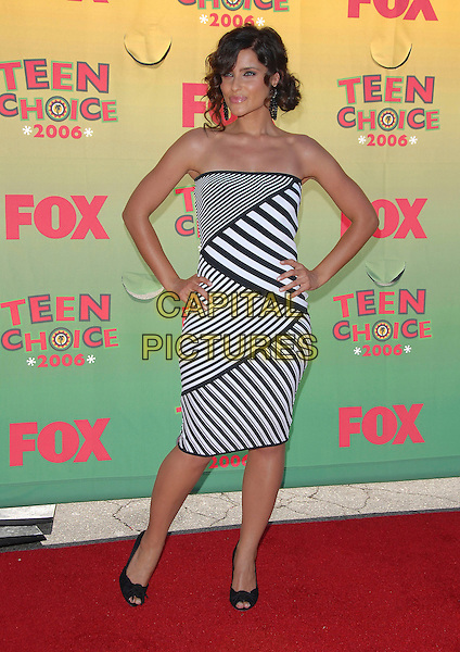 NELLY FURTADO.At The 2006 Teen Choice Awards - Arrivals, .held at The Universal Ampitheatre in Universal City, California, USA, August 20th 2006..full length black and white print striped strapless dress  peeptoe bow court shoes hands on hips.Ref: DVS.www.capitalpictures.com.sales@capitalpictures.com.©Debbie VanStory/Capital Pictures