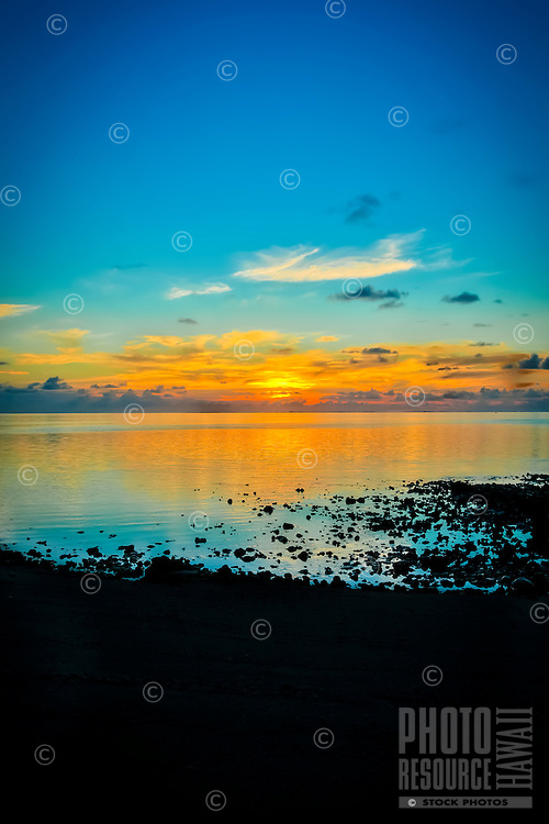 Sunset at Amuri Beach, Aitutaki Island, Cook Islands.