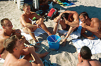 "Spain. Mallorca in the Balearic islands. Palma. German tourists (young men) drink sangria with big straws from a large blue bucket on the sandy beach of the "" Playa de Palma"" in front of the Balneario 6. © 1999 Didier Ruef"