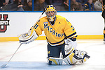 March 26,  2011                     Michigan goalie Shawn Hunwick (31) uses his stick to help himself up off the ice in the second period. The University of Michigan beat Colorado College 2-1 in the championship game of the NCAA Division 1 Men's West Regional Hockey Tournament, on Saturday March 26, 2011 at the Scottrade Center in downtown St. Louis.