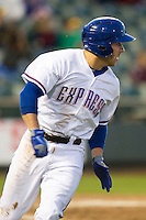Round Rock Express third baseman Mike Olt #20 rounds first base against the Omaha Storm Chasers in the Pacific Coast League baseball game on April 4, 2013 at the Dell Diamond in Round Rock, Texas. Round Rock defeated Omaha in their season opener 3-1. (Andrew Woolley/Four Seam Images).
