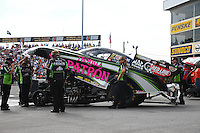 Oct 4, 2013; Mohnton, PA, USA; Crew members for NHRA funny car driver Alexis DeJoria wait for the signal to start up during qualifying for the Auto Plus Nationals at Maple Grove Raceway. Mandatory Credit: Mark J. Rebilas-