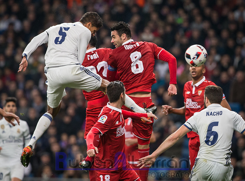 Real Madrid's French defense Raphael Varane scoring a goal during the Copa del Rey soccer match between Real Madrid and Sevilla played at the Santiago Bernabéu stadium in Madrid, on January 4th 2017.