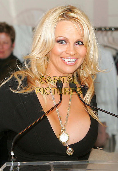 PAMELA ANDERSON.At the an event hosted by PETA (People for the Ethical Treatment of Animals) to honor people who have made outstanding contributions in promoting PETA campaigns that take a stand against cruelty to animals,.New York, NY, USA, 03 February 2006..half length lee gold necklaces lockets cleavage boobs.Ref: ADM/JL.www.capitalpictures.com.sales@capitalpictures.com.© Capital Pictures.