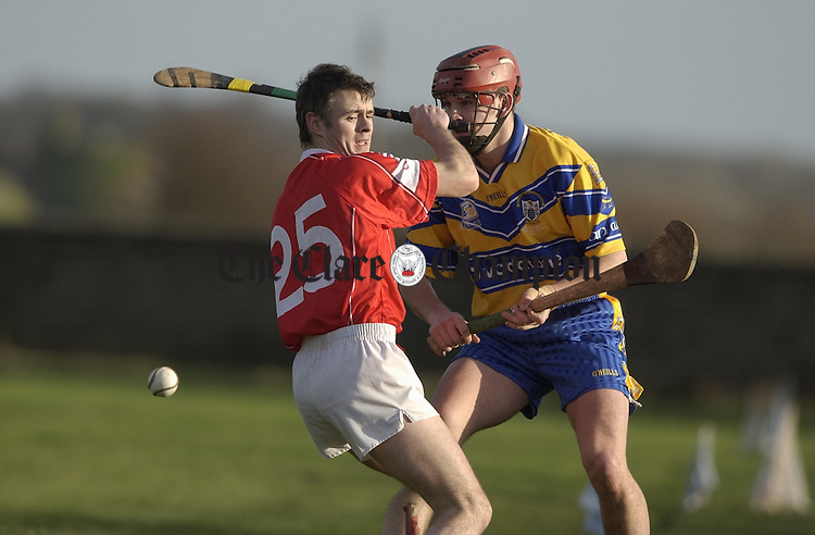 Seanie Mc Grath of Cork and gerry O Grady of Clare meet during the hurling challenge game at Clareabbey. Photograph by John Kelly.