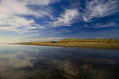 Cloud reflections in wet sand at Hukatere, Ninety Mile Beach