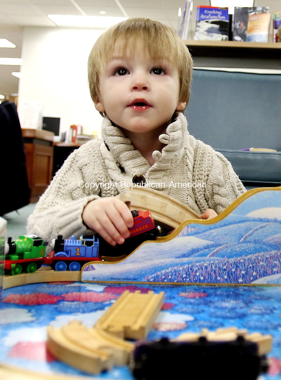 MIDDLEBURY CT. 11 January 2015-011116SV05-Chase Thompson, 2, of Middlebury drives his train over the hill on a train table during during a One Plus One program for toddlers at the Library in Middlebury Monday. <br /> Steven Valenti Republican-American