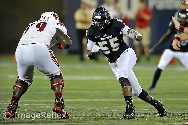 20 September 2014:  FIU defensive end Michael Wakefield (55) pursues the ball carrier in the second half as the University of Louisville Cardinals defeated the FIU Golden Panthers, 34-3, at FIU Stadium in Miami, Florida.