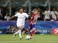 Calcio, finale di Champions League: Real Madrid vs Atletico Madrid. Stadio San Siro, Milano, 28 maggio 2016.<br /> Real Madrid's Marcelo, left, is chased by Atletico Madrid Antoine Griezmann during the Champions League final match between Real Madrid and Atletico Madrid, at Milan's San Siro stadium, 28 May 2016.<br /> UPDATE IMAGES PRESS/Isabella Bonotto