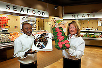 New Bloom Seafood Coordinator Tony Onyenagiri (left) and Market Manager Stephanie Brooks (right).