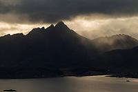 Autumn rainstorm over Skottind mountain peak, Vestvågøy, Lofoten Islands, Norway