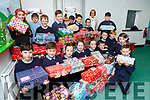 Delia O'Shea and pupils from Faha NS and Faha Childcare with some of the 200 plus Christmas shoeboxes that were collected on Wednesday (no name Policy)