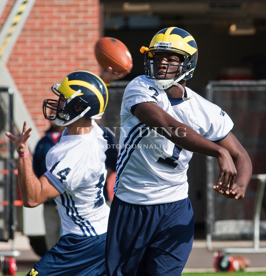 Michigan quarterbacks Nader Furrha (14) and Devin Gardner, right, participate in a passing drill on the first day of spring football practices, Tuesday, March 16, 2010, in Ann Arbor, Mich. (AP Photo/Tony Ding)