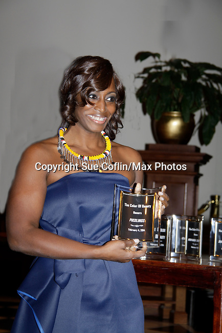 Bisila Bokoko receiving award for Pikolas and herself - Color of Beauty Awards on February 4, 2014 at Holy Apostles, New York City, New York. (Photo by Sue Coflin/Max Photos)