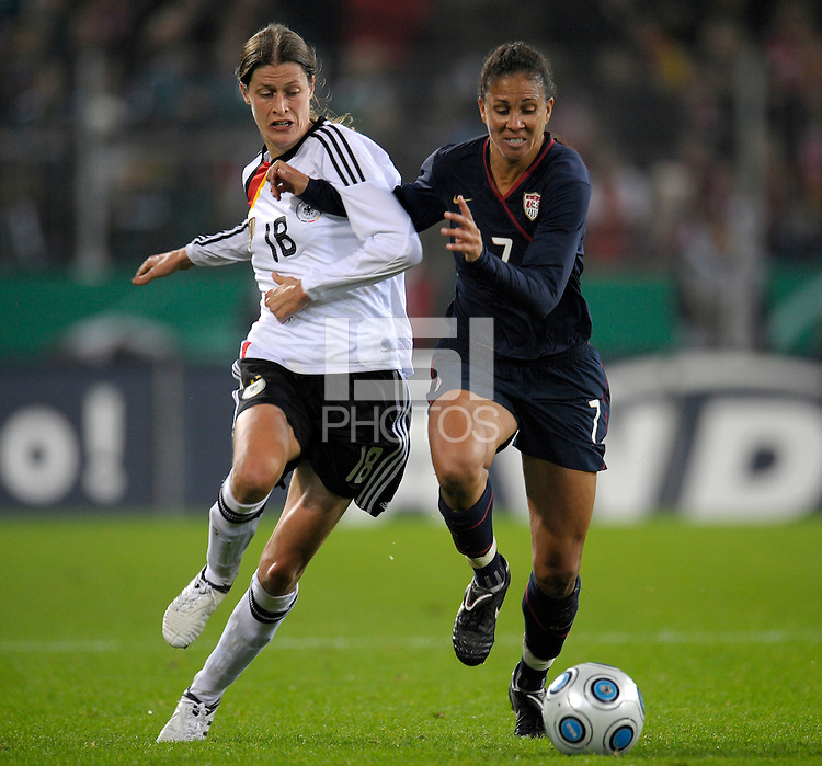 Shannon Boxx (7) battles against Kerstin Garefrekes (18). US Women's National Team defeated Germany 1-0 at Impuls Arena in Augsburg, Germany on October 29, 2009.