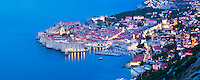 Dubrovnik Old Town at night, panoramic photo taken from Zarkovica Hill, Dalmatian Coast, Croatia, Europe. This panoramic photo of Dubrovnik Old Town at night, jutting out into the Mediterranean Sea was taken from Zarkovica Hill on the Dalmatian Coast in Croatia. By far the best views of Dubrovnik Old Town are from elevated points such as Zarkovica Hill.