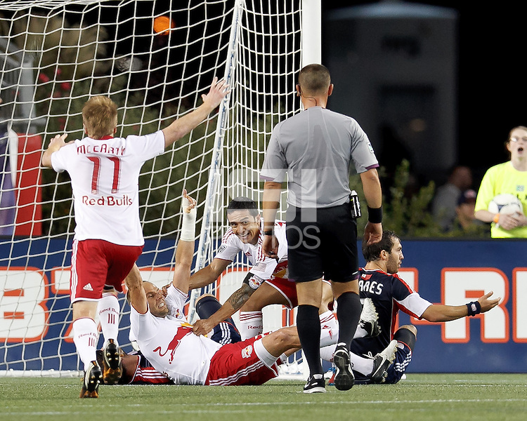 New York Red Bulls substitute midfielder Joel Lindpere (20) and New York Red Bulls forward Tim Cahill (17) celebrate first goal of the match after the red card. Despite a red-card man advantage, in a Major League Soccer (MLS) match, the New England Revolution tied New York Red Bulls, 1-1, at Gillette Stadium on September 22, 2012.